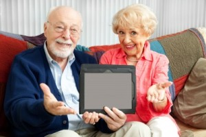 older couple holding tablet calling you over