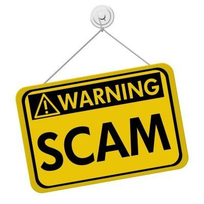 yellow sign saying: warning scam