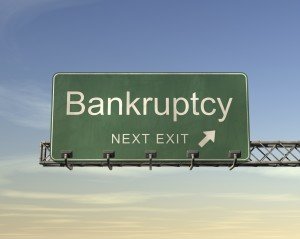 Green sign saying Bankruptcy, Next Exit