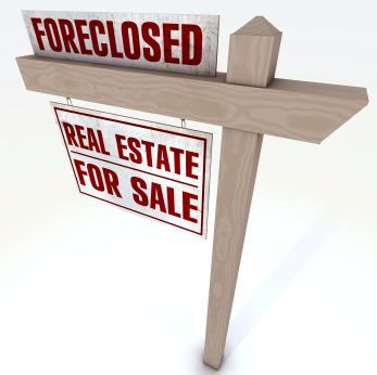 foreclosure sign stating real estate for sale