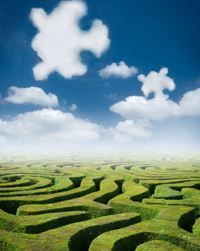 green grass maze with puzzle pieces as clouds