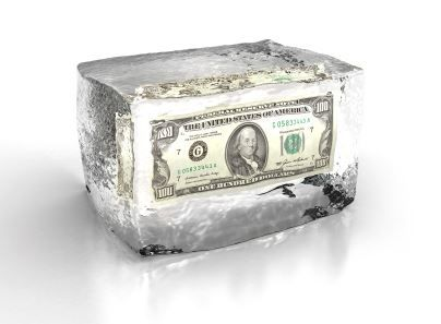 dollar bill inside a brick of ice