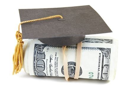 roll of money with graduation cap on top