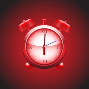alarm clock in red background