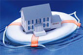 toy house floating on boat life saver in ocean